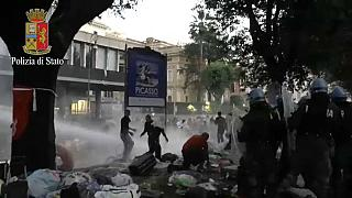 Refugees and riot police clash in Rome