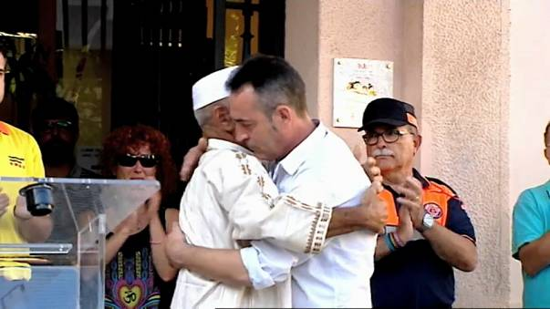 Father of three-year-old Barcelona attack victim hugs imam
