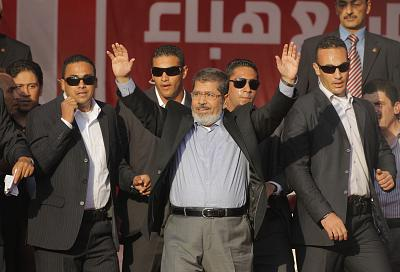 Egypt\'s President-elect Mohammed Morsi waves to supporters at Tahrir Square in Cairo, Egypt, on June 29, 2012.