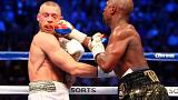 US boxer Floyd Mayweather triumphs over UFC champion Conor McGregor