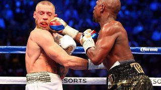 US boxer Floyd Mayweather triumphs over UFC champion Conor McGregor