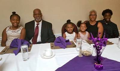 Anthony and Gwendolyn Fleming with their grandchildren.