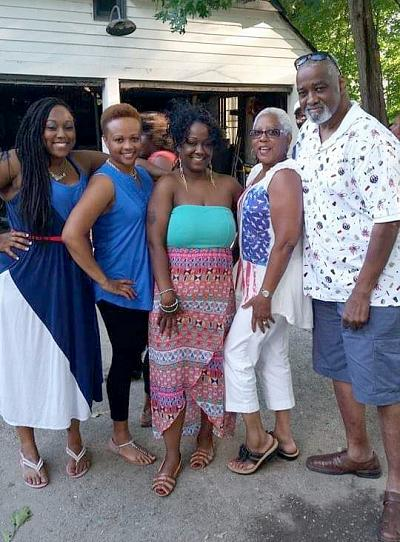 Ashley, Monique and Alicia with their parents, Gwendolyn and Anthony Fleming.
