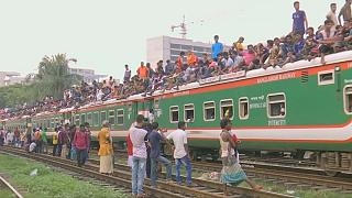 Bangladeshis swarm Dhaka trains to travel home for Eid al-Adha