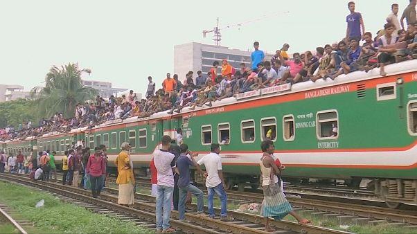 Bangladeshis swarm Dhaka trains to travel home for Eid al-Adha
