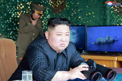 "North Korean leader Kim Jong Un supervises a ""strike drill"" in a photo taken by the official Korean Central News Agency on Saturday."