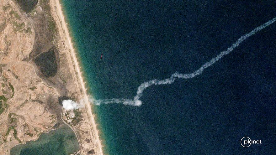 Image: The trail of a suspected North Korean missile is captured in a comme