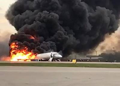 The Aeroflot plane burns after making an emergency landing on Sunday.