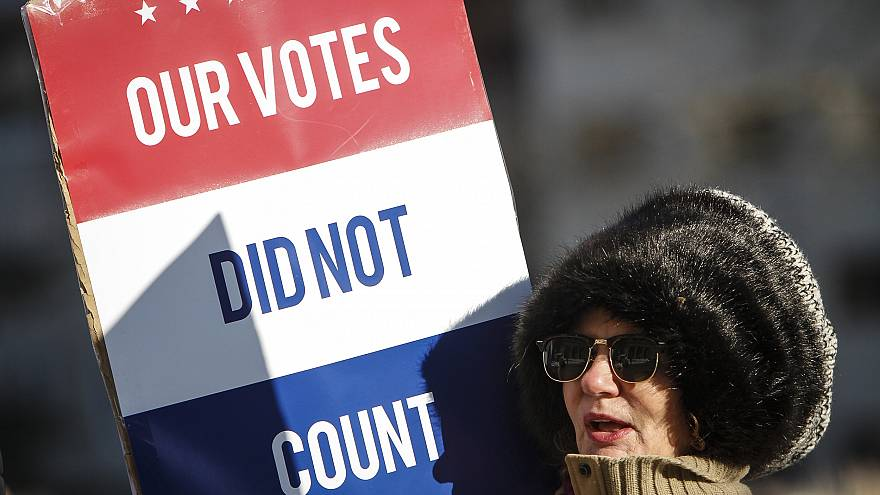 A protester at a rally at the Michigan State Capitol before the state elect