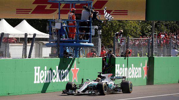 Britain's Lewis Hamilton wins Italian Grand Prix and takes lead in F1 championship