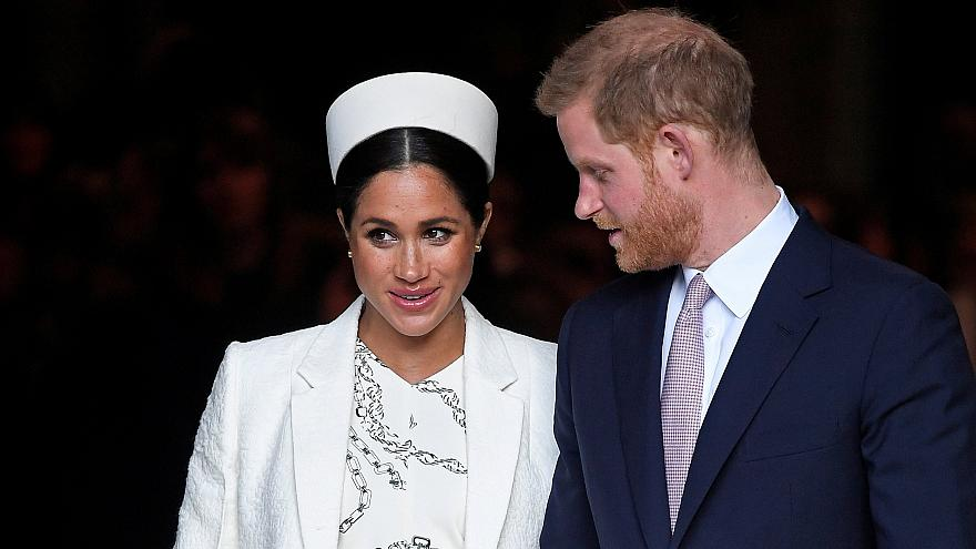 Britain's Prince Harry and Meghan, Duchess of Sussex, leave after the Commo