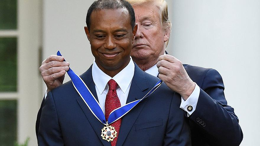 Image: Golfer Tiger Woods is awarded the Presidential Medal of Freedom at t