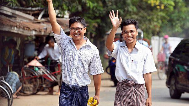 Image: Reuters reporters Wa Lone and Kyaw Soe Oo gesture as they walk free