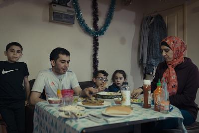 Mohammad Karkoubi, wife Eshraq with their children in their rented apartment in Aberystwyth, Wales.