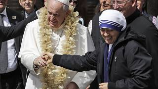 Image: Pope Francis is welcomed by a nun as he arrives at Mother Teresa's m