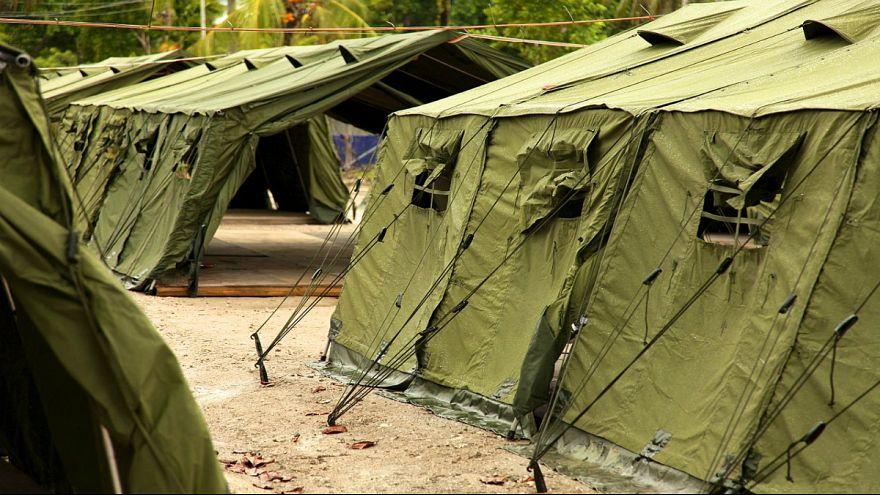 پناهجویان جزیره مانوس غرامت میگیرند