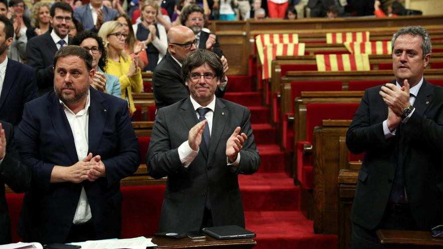 The Catalan parliament approves a law to call a referendum on October 1 on independence from Spain
