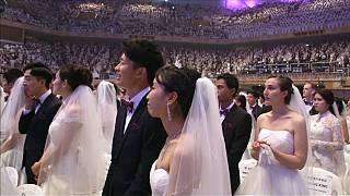 Unification church couples over the moon at mass wedding