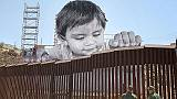 Art without borders: 'French Banksy' produces touching portrait of boy looking over US-Mexico border