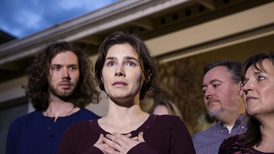 Image: Amanda Knox speaks to the media outside of her parents home in Seatt