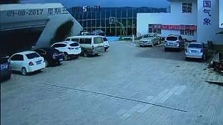 Watch: CCTV captures wall collapsing and flattening cars
