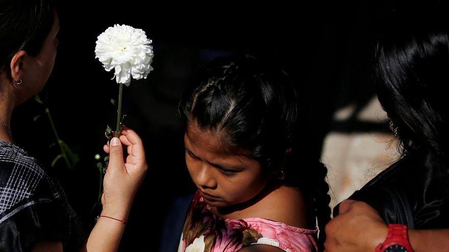 Mexico mourns earthquake victims as Katia makes landfall