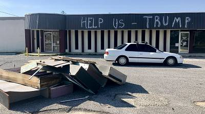 An abandoned storefront in Panama City Beach, Florida, features a message for President Trump, who is set to visit the hurricane-torn region on May 8, 2019.