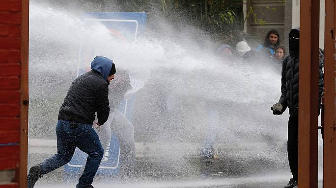 Chile clashes: violence breaks out during protest to mark coup anniversary