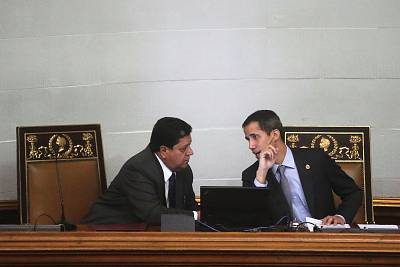 Venezuelan opposition leader Juan Guaido, who many nations have recognized as the country\'s rightful interim ruler, speaks with Edgar Zambrano, the assembly vice president, in a session of the National Assembly in Caracas, Venezuela on March 6, 2019.