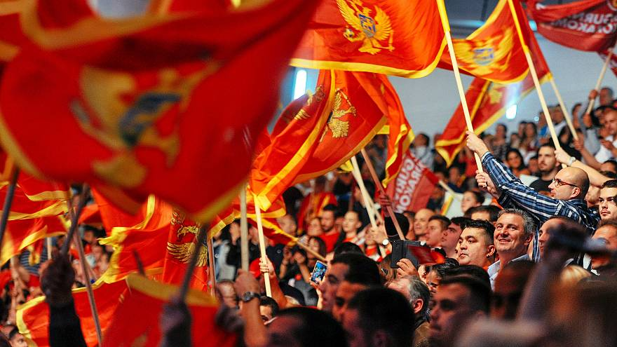 Image: Supporters of Montenegrin Prime Minister Milo Djukanovic wave flags