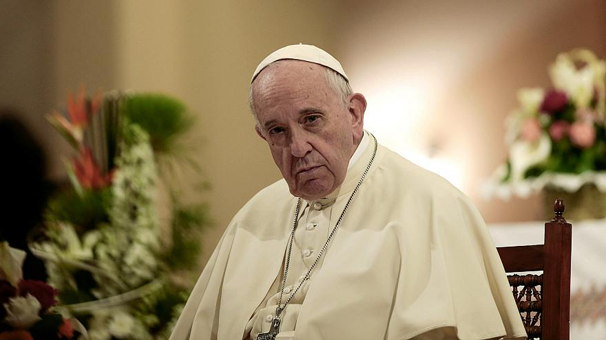 Image: Pope Francis sits during a meeting with Catholic priests and other r