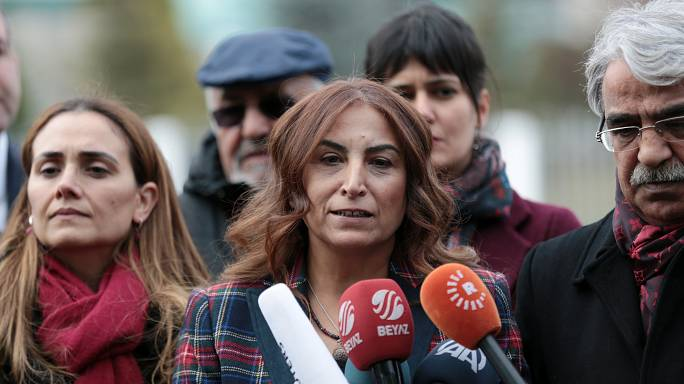 Turkish politician forced to dig up mother's grave after threats