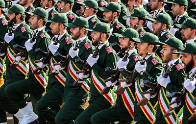 Members of Iran\'s Revolutionary Guards Corps (IRGC) march during the annual military parade marking the anniversary of the outbreak of the devastating 1980-1988 war with Saddam Hussein\'s Iraq, in the capital Tehran.