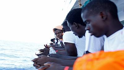 NGO rescues over 100 migrants at sea, watched by Libyan coastguard