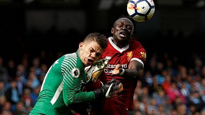 Liverpool's Senegalese forward Mane will not change style despite ban