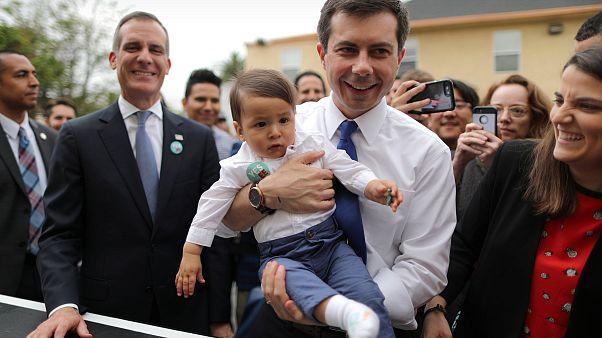 Image: U.S. Democratic presidential candidate Mayor Pete Buttigieg picks up