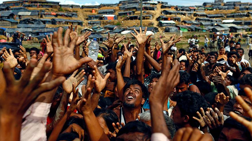 Hungry Rohingya refugees rush for handouts at Bangladesh camp