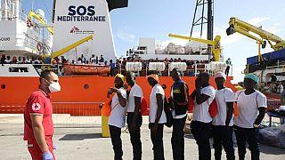 Hundreds of migrants disembark at Sicilian port of Trapani