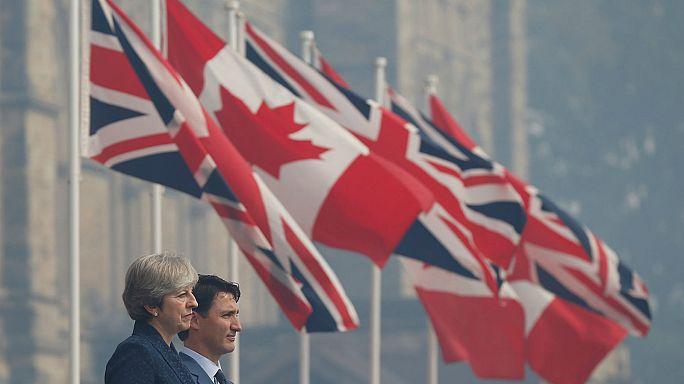 تيريزا ماي تناقش في كندا التدابير التجارية في مرحلة ما بعد البربكسيت