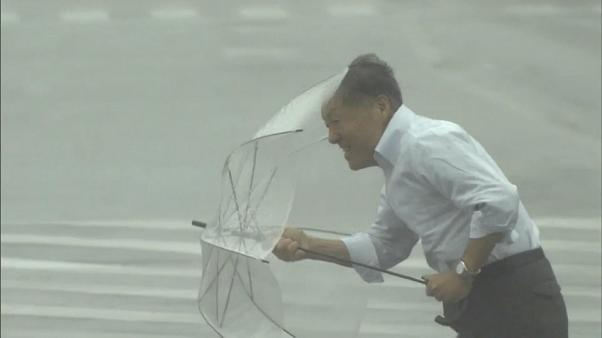 Typhoon Talim: at least two dead as storm sweeps Japan