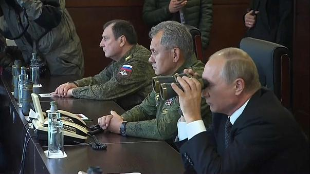 Vladimir Putin looks on as Russia flexes its military muscles