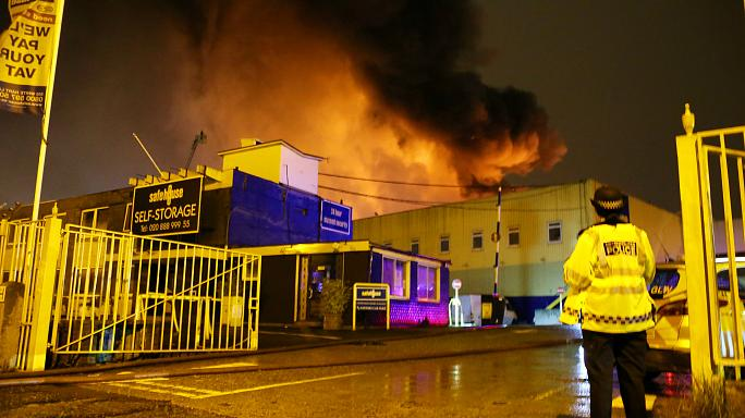 Over 100 firefighters tackle massive warehouse fire in London