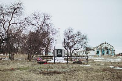 An abandoned Soviet-era House of Culture and a World War II monument in Yakshina, Russia.