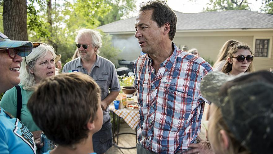 Image: Montana Governor Steve Bullock campaigns at a gathering of Democrats