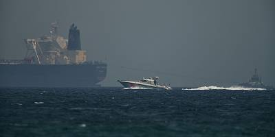 A coast guard vessel passes an oil tanker off the coast of Fujairah, United Arab Emirates, on Monday.