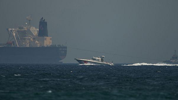 Image: A coast guard vessel passes an oil tanker off the coast of Fujairah,