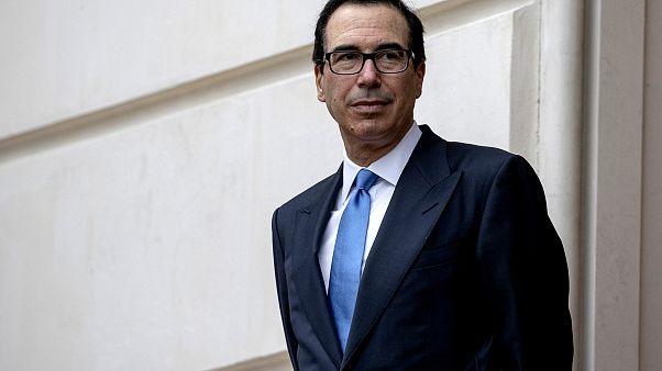 Image: Treasury Secretary Steve Mnuchin waits outside the Office of the U.S