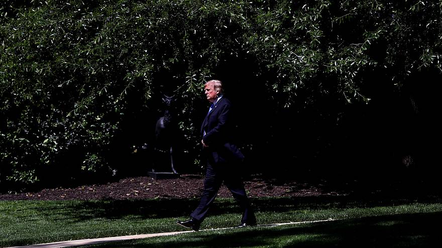 Image: President Donald Trump leaves the White House on May 14, 2019.