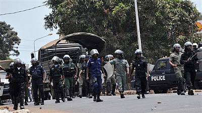Rioters burn down police buildings in Guinea mining town, 17 injured