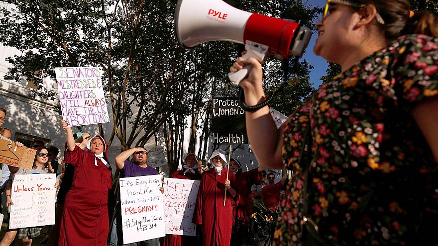 Image: Pro-choice supporters protest in front of the Alabama State House as